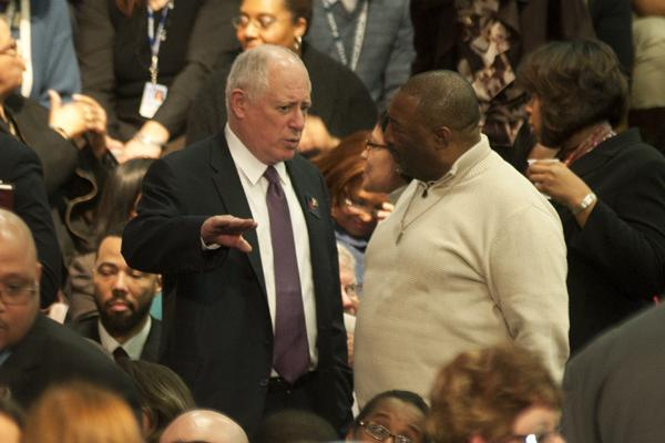 Illinois Gov. Pat Quinn (left) speaks to an attendee of President Barack Obama's post-State of the Union speech at Hyde Park Academy. Quinn proposed steep cuts and pension reform during his Fiscal Year 2014 budget address Wednesday.