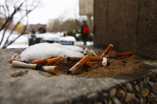 Cook County enacted a $1 per packet cigarette tax Friday to discourage smoking.