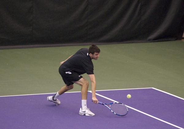 Senior Chris Jackman reaches to return a low shot near the line. During Northwestern's weekend loss, Jackman won his singles match in a third-set tiebreaker against Illinois, but said losing the doubles point was a blow to Northwestern's momentum.