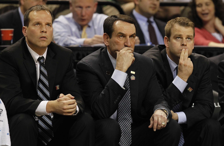 Chris Collins (left) watches a Duke game with fellow coaches Mike Krzyzewski and Steve Wojciechowski. Collins was named Northwestern's head basketball coach Wednesday.