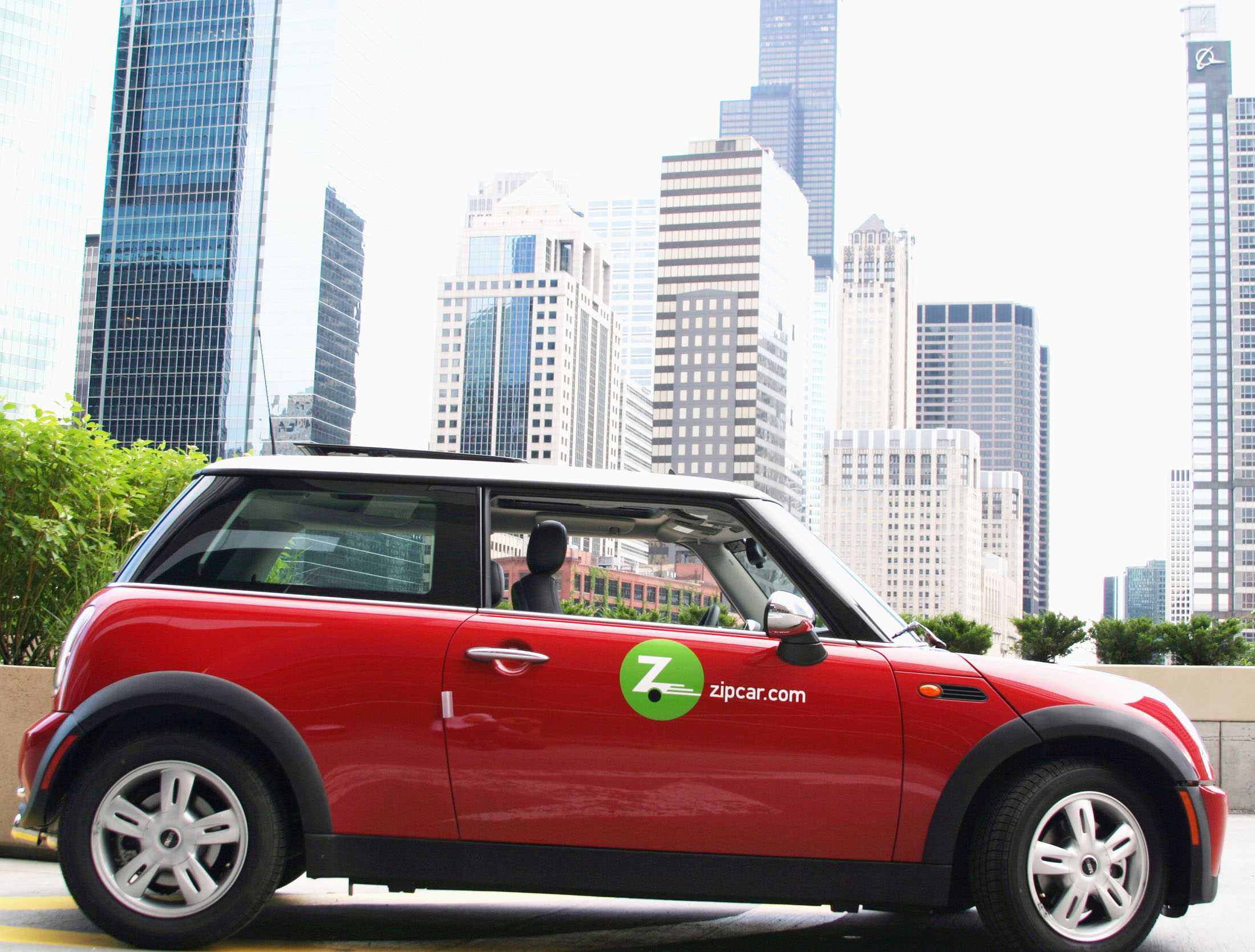 A Zipcar Mini Cooper parked in downtown Chicago. Charles Stevens (Ph.D '76), general manager of Zipcar Chicago, spoke at Wednesday night's ASG Senate about possibly bringing the car-sharing organization to Northwestern's campus.