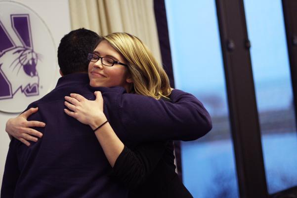 ASG outgoing Speaker Ani Ajith hugs his successor after delivering his final remarks in the position at Wednesday's meeting. Ajith told the ASG Senate to remember the power of their voice.