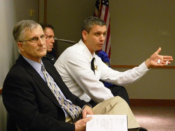 Evanston Police Chief Richard Eddington (left) listens while Cmdr. Jay Parrott (right) talks to residents during Wednesday's crime beat meeting focusing on wards one, three, four and seven.