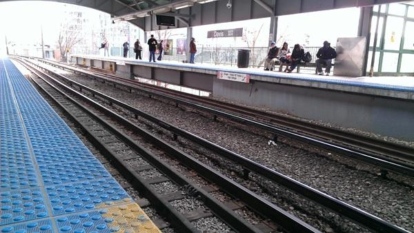 Commuters wait for a Chicago-bound train at the Davis Street CTA station in April. Earlier this year, the CTA began its first major upgrade to the Purple Line in nearly four decades.
