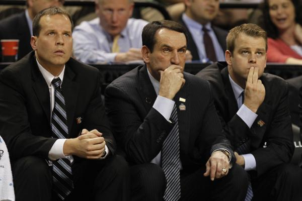 Chris Collins (left) watches a Duke game with fellow coaches Mike Krzyzewski and Steve Wojciechowski. Collins was named Northwestern's head basketball coach Wednesday.