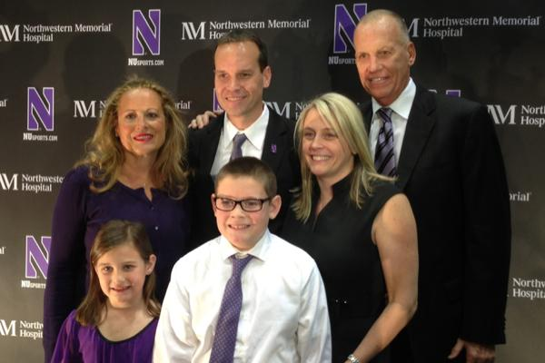 Newly-introduced men's basketball coach Chris Collins (center) was joined at Tuesday's news conference by his family, including father Doug (far right), the head coach of the NBA's Philadelphia 76ers.