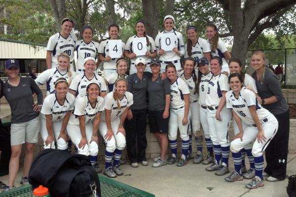 Northwestern softball coaches Kate and Caryl Drohan (left to right in center with gray shirts) won their 400th game at NU earlier this year. The identical twins miss talking to their dad after softball games about the contests.