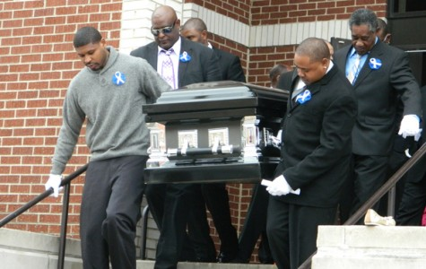 Pallbearers carry Evanston Township High School senior Kevoyn Cox's casket from the First Church of God Christian Life Center on Saturday. Cox died in a car accident last month.