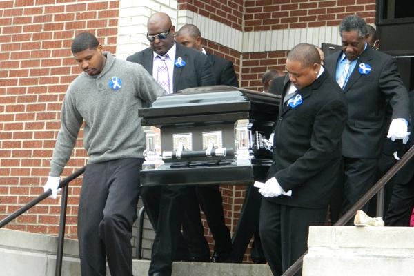 Pallbearers carry Evanston Township High School senior Kevoyn Coxs casket from the First Church of God Christian Life Center on Saturday. Cox died in a car accident last month.