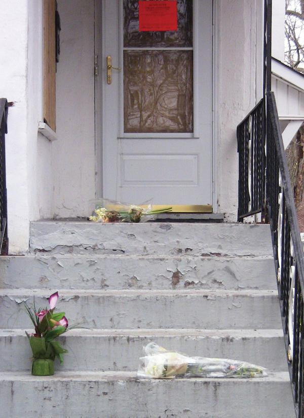 Flowers+commemorate+longtime+Friendship+Baptist+Church+member+Freddie+Davis+who+died+Wednesday+after+he+was+caught+in+a+house+fire+on+the+1900+block+of+Hartrey+Avenue.