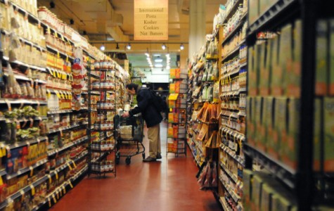 A customer peruses the shelves of Whole Foods Market in Evanston. The grocery store is one of several businesses in Evanston that accepts food stamps.