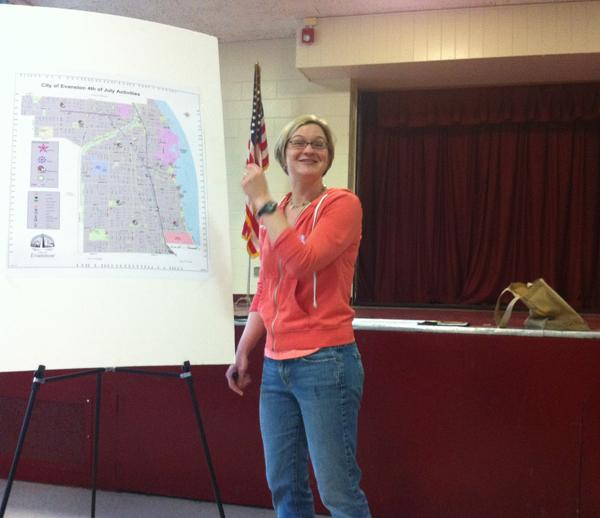 Joan Ducayet, former Evanston 4th of July president, discusses potential new playground sites for Independence Day celebration during a public meeting hosted by her organization and the city.