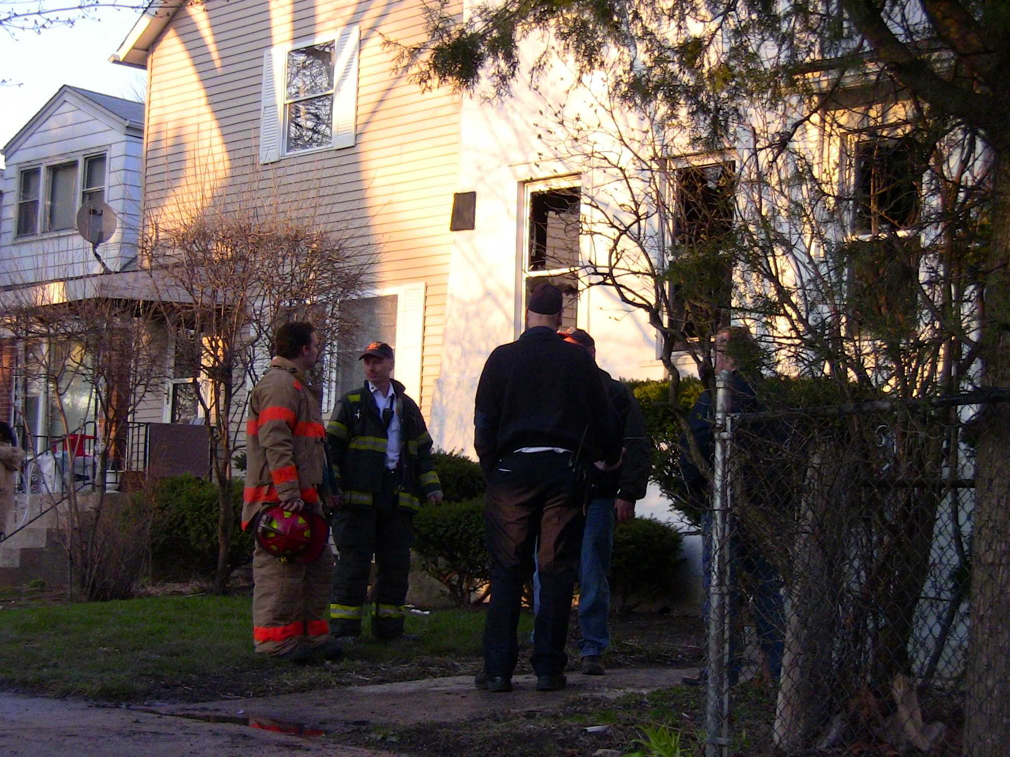Evanston firefighters and officials examine the damage of a fire Wednesday evening. The blaze broke out in the 1900 block of Hartrey Avenue.