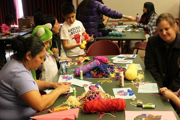 The city has made efforts to reach out to Evanston's growing Latino population. Above, children and parents participate in an event in honor of Latino activist Cesar Chavez at the Evanston Public Library on Saturday.