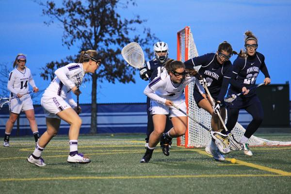 Junior Alyssa Leonard goes for a ground ball against Penn State. Leonard and the Wildcats rallied Sunday to defeat Virginia 11-6.