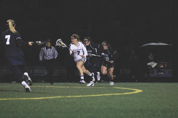 Senior attack Erin Fitzgerald streaks toward the goal against Penn State earlier this season. The senior, who leads Northwestern in goals, was held to only 4 shots and 2 goals on Saturday in the team's loss against Florida.