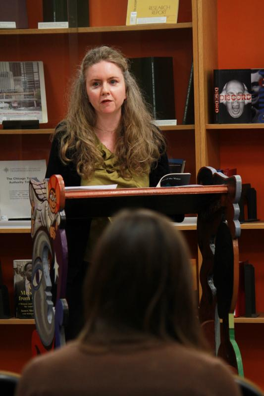Christina Pugh, an Evanston poet, speaks at the University Library to kick off Library Week. The library planned events throughout the week to celebrate its many resources.