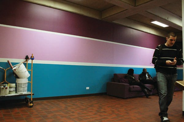 Students relax on the new couches in the main lobby of Norris. In addition to the new furniture and decorations, a larger US Bank office will open at the end of April.