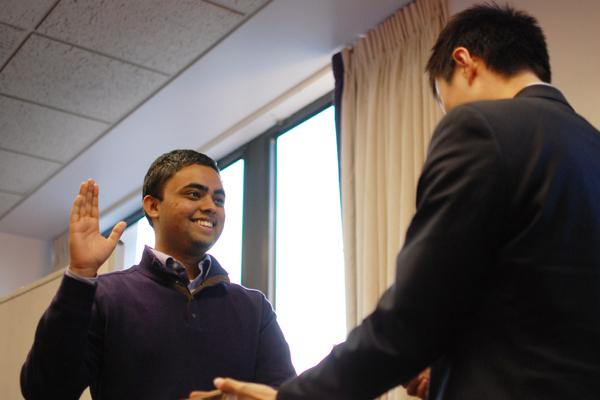 Victor Shao (right), swears in Ani Ajith (left), the new president of Associated Student Government at the senate meeting Wednesday evening.