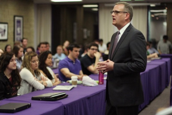 New Dean of Students Todd Adams fields questions at a past meeting of the Associated Student Government Senate. Adams joined Northwestern in early February.