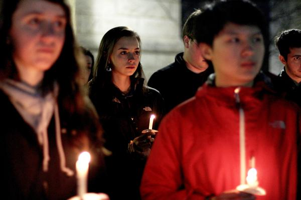 Students stand by in silent respect as leaders from Northwestern religious communities share words and prayers for the victims of the tragedy in Boston and the effect it has had on all.