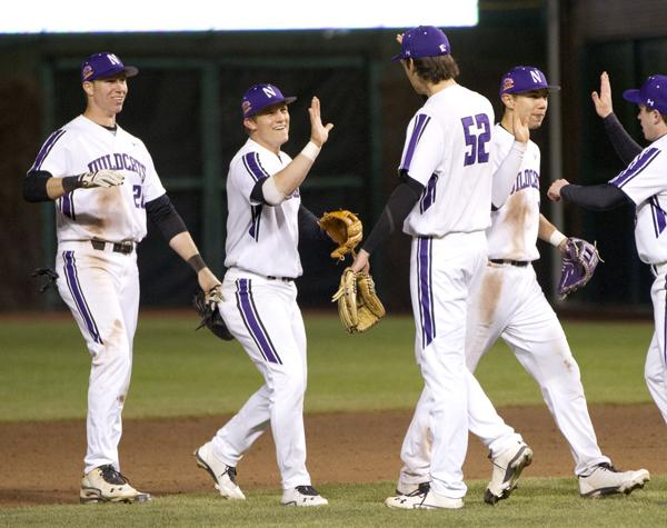 The Wildcats come out to celebrate the team's 6-0 win over Michigan on Saturday at Wrigley Field. It was the first game under the new partnership between NU and the Chicago Cubs and nearly 4,200 people were in attendance at the game.