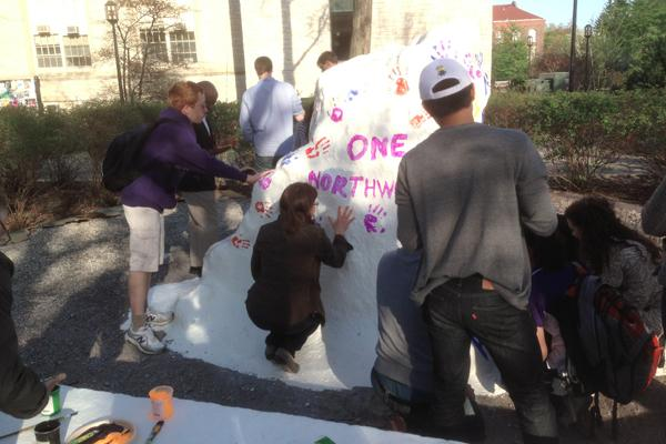 Marianna Teplova, mother of Dmitri Teplov, adds her own handprint to The Rock.