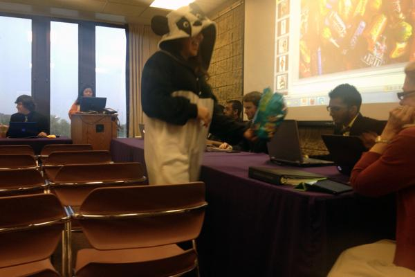 Members of the Northwestern Community Development Corps in costume pass out candy during Wednesday's Senate meeting. The candy was part of the organization's request for more funding for their Halloween event, Project Pumpkin.