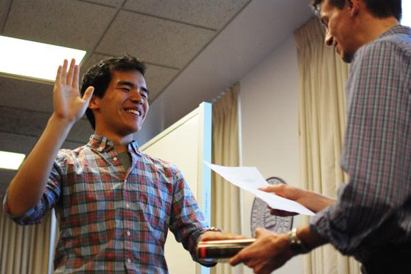 Sheng Wu (left) is sworn in as technology vice president at the Associated Student Government meeting Wednesday evening. Three other nominees for executive board were also confirmed at the meeting, while three were rejected.