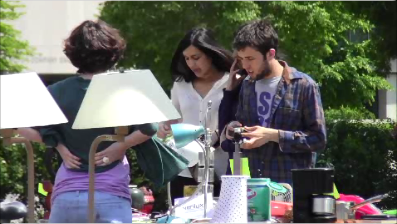 Associated Student Government community relations committee member Mike Morgan (right) brought up the idea of garage sale where off campus students could sell goods before the school year ends. About 20 students attended the garage sale on Sunday.