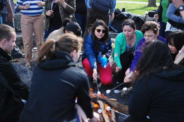 Students roast marshmallows over a fire during the Alianza Fuego Bonfire Sunday afternoon. The event not only celebrates Cinco de Mayo, but also aims to show how to respectfully celebrate the holiday.