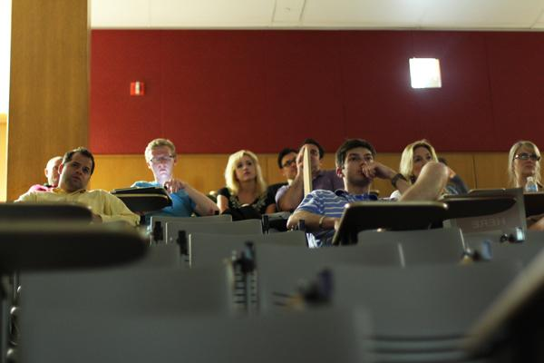 Fans of the late conservative Andrew Breitbart watch a documentary about his life Tuesday night in a Technological Institute auditorium. Conservative activist James OKeefe and the films director took questions after the screening.