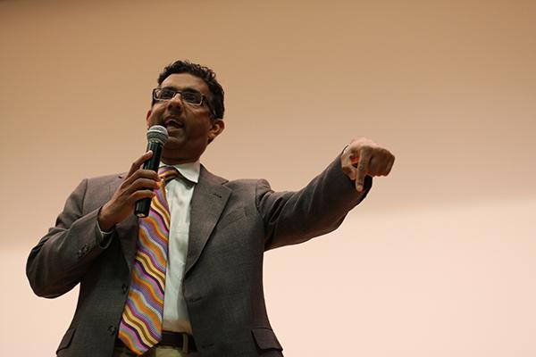 Conservative commentator Dinesh DSouza delivers a talk Monday evening about his views on diversity. Some students protested the talk outside Ryan Auditorium in the Technological Institute.