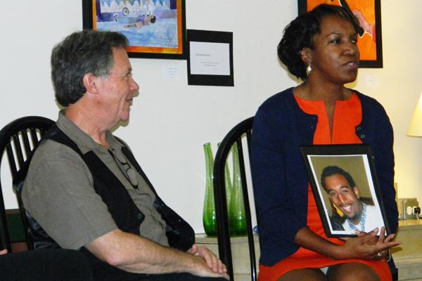 Dan Anthon and Carolyn Murray discuss gun violence at a panel at Curt's Cafe on Wednesday evening. The discussion covered the impact of guns on the community and movements to end the violence.