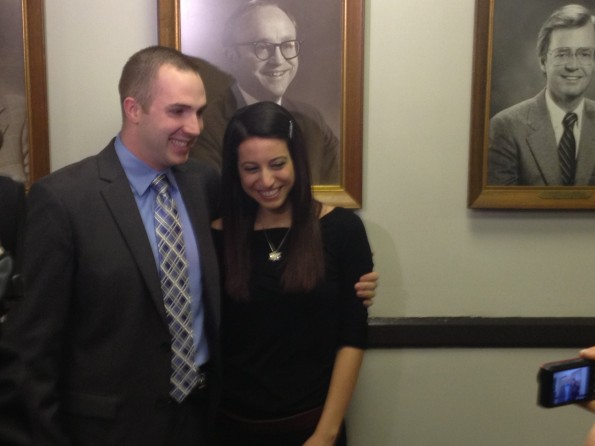 Evanston Police officer Sean O'Brien and his girlfriend Mallory Navarra pose for photos outside the city council chamber at a March ceremony. O'Brien was given the Illinois Department of Public Health's Hero Award on Wednesday.