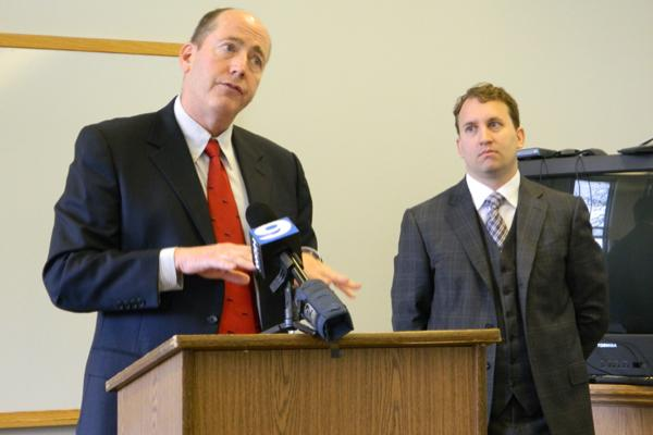 Attorneys William McKenna and Grant Farrar explain the city's victory in a legal battle against a Chicago school at a news conference Monday. They were joined by Ald. Ann Rainey (8th).