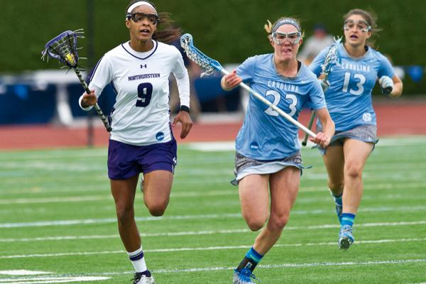 Taylor Thornton runs away from North Carolina defenders during Northwestern's semifinal match against the Tar Heels. Thornton was held scoreless during the Wildcats' 11-4 loss.