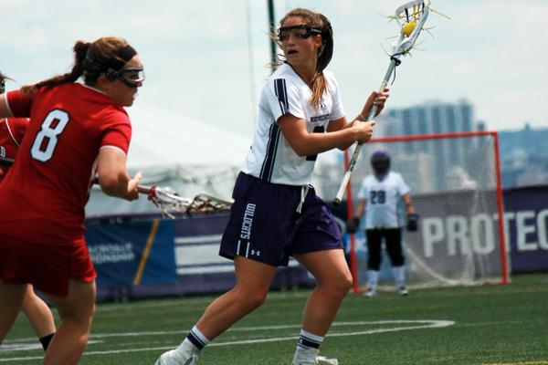Northwestern junior Alyssa Leonard looks to pass in the midfield Sunday against Sanford. Leonard, who owns the NU single-season record for draw controls with 120 so far this season, won 8 draw controls and scored 3 goals in the second round of the NCAA Tournament.