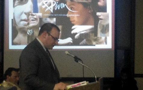 Joel Freimuth gives a presentation to the Human Services Committee about the Piven Theater expansion proposal. The meeting took place on Tuesday evening at the Lorraine H. Morton Civic Center.