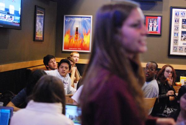 Weinberg senior Monica Magda (foreground) reads off trivia questions to Relay for Life team members at Buffalo Wild Wings Wednesday night.