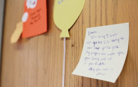 Students have left Post-It notes with condolences on the door of McCormick sophomore Dmitri Teplov. Teplov, 20, was found dead Sunday morning in Pancoe Hall.