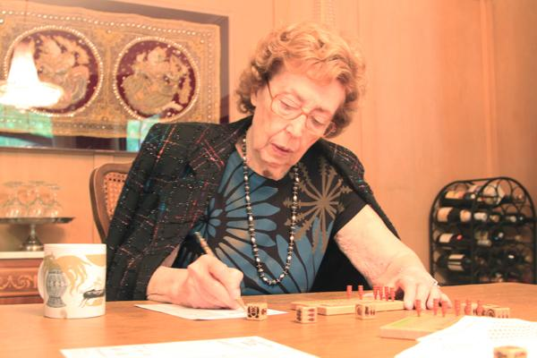 Jacqueline Goldberg, 87, studies the score pad of