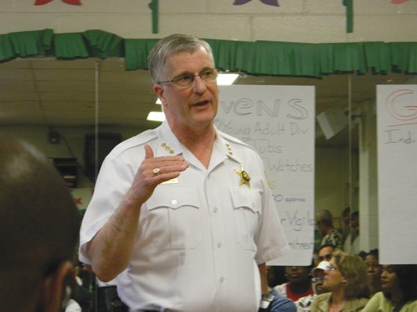 Evanston Police Chief Richard Eddington announces an increase in police presence in the west end as a result of recent gun violence. More than 100 people gathered at the Fleetwood-Jourdain Community Center on Thursday to discuss the increase in violence.