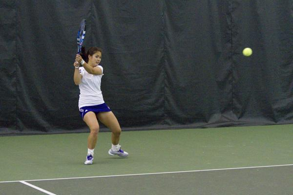 Nida Hamilton sends a shot cross court. Hamilton, a junior, and senior Linda Abu Mushrefova performed consistently well in doubles' play throughout the season for NU, but lost to the No. 2 team from the University of Southern California in the first round of the NCAA Tournament.
