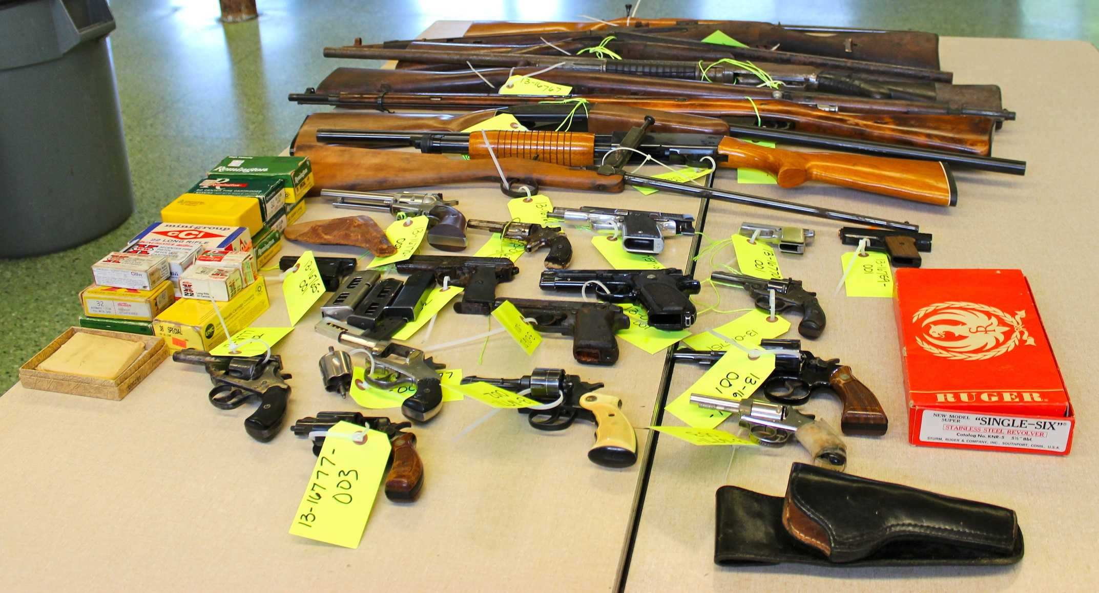 Police officers displayed the firearms they collected at Evanston's second gun buyback event on Saturday. Police Chief Richard Eddington said he hopes to make the service available to residents on a daily basis.