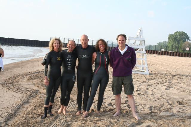 Members of team Open Water on Lee (five of seven pictured) will brave Lake Michigan at midnight Saturday to raise money for cancer research. The swimmers are North Shore residents and members of the local swim community.