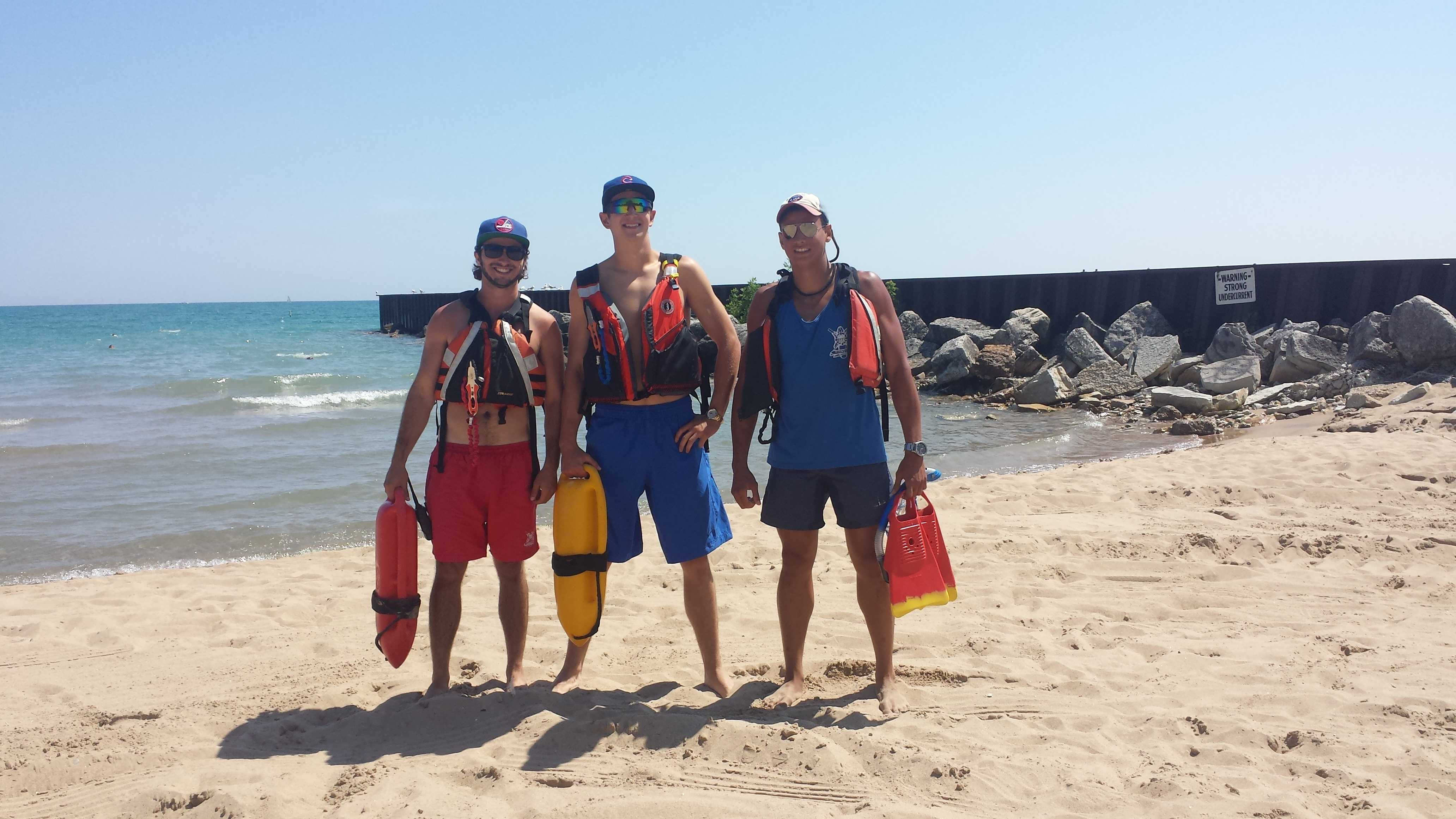 Evanston lifeguards David Altman, Jack Killheffer and Tudor Byas were honored by Mayor Elizabeth Tisdahl at Monday's City Council meeting. The lifeguards rescued a man whose boat sank earlier this month about a mile and a half off the coast of the Northwestern campus.
