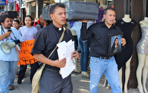 The Rev. Jose Landaverde leads about 40 protestors as they begin their march to Northwestern Memorial Hospital on Sunday afternoon. The group carried caskets to represent those who died while waiting for organ transplants.