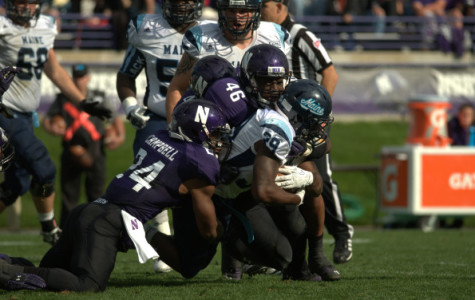 Junior safety Ibraheim Campell and senior linebacker Damien Proby tackle Maine's Rickey Stevens to the dirt. The Northwestern defense proved to be the strong side of the team Saturday, earning two interceptions and scoring on both turnovers.