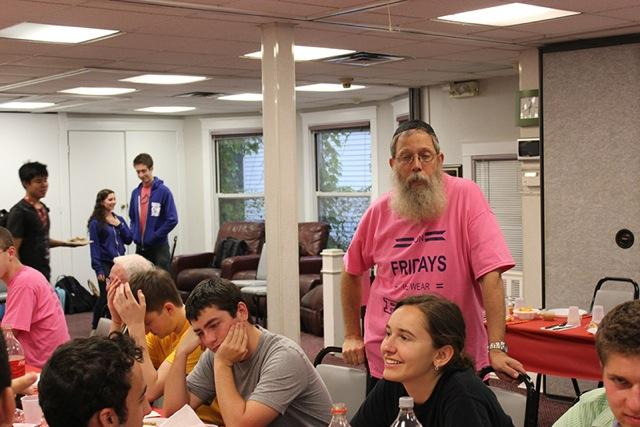 Rabbi+Klein+greets+students+at+the+annual+Chinese+Welcome+Week+dinner.+Fewer+students+attended+this+year%27s+event.+%0D%0A